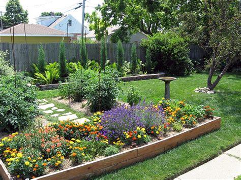 Beautiful blooms enhance this raised garden area garden photos