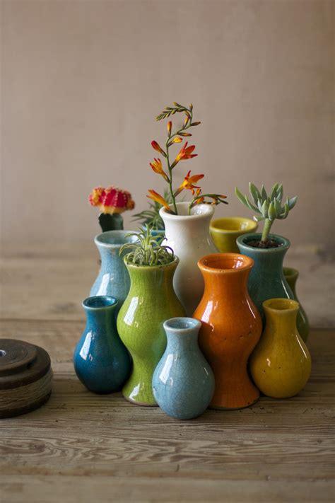 set of thirteen nesting multi colored ceramic bud vases
