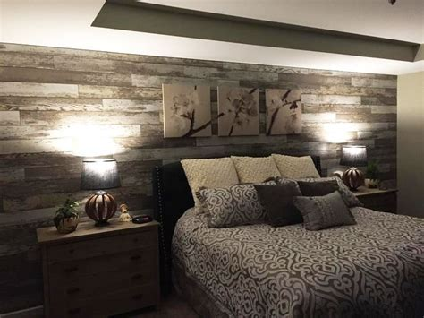 """""""Added laminate flooring to bedroom wall to give the room"""
