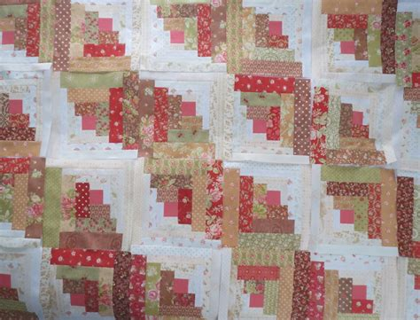 quilting on log cabin quilt block settings