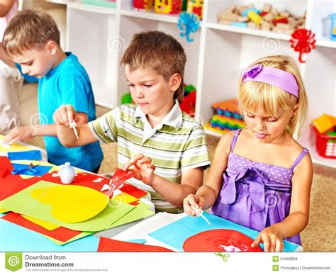 Paper With Children - child cutting out scissors paper stock photo image