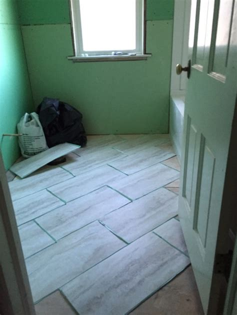 how do you lay tile in a bathroom which direction should i lay the 12x24 vinyl tiles in our