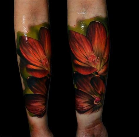 arm realistic flower tattoo by samuel potuček tattoo