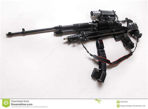 camera gun wallpaper photo equipment in the shape of a gun stock photo image