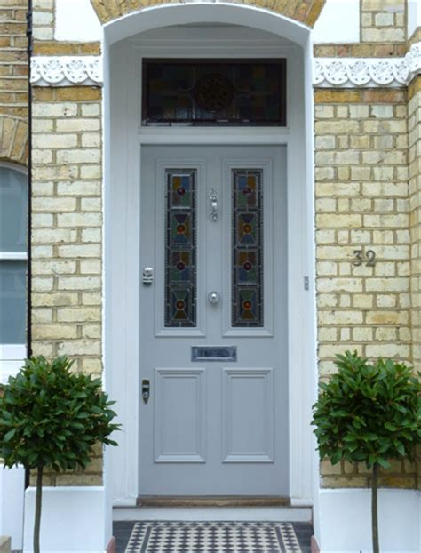 Front Door Company Entrance And Front Door Of A House With A Lying By The Door Curb Appeal