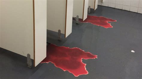 blood loss in a bathroom stall square enix advertises hitman by putting blood trails in