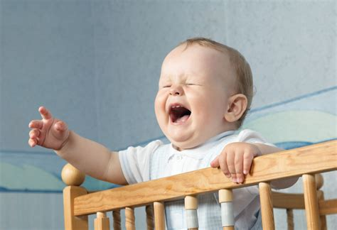 Baby In A Crib Battle Of The Opinions Letting Infants Cry It Out Intelligent Nest Llc
