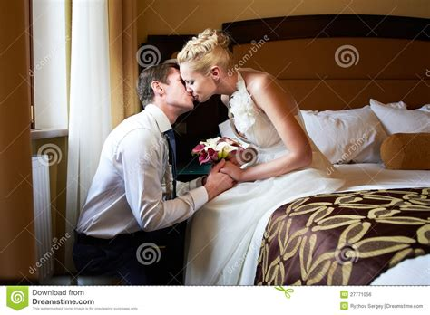 bedroom kissing romantic kiss bride and groom in bedroom royalty free