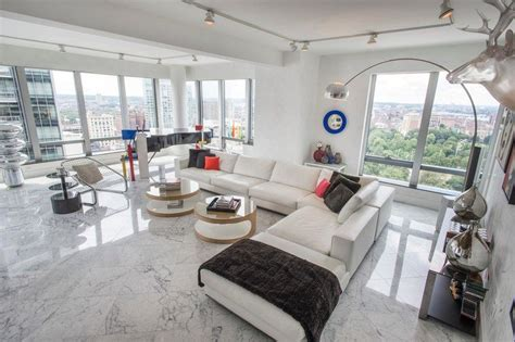 Délicieux Carrelage Sol Sejour Salon #2: carrelage-sol-marbre-salon-carrelage-marbre-blanc-canap%C3%A9-xxl-accents-m%C3%A9tal.jpg