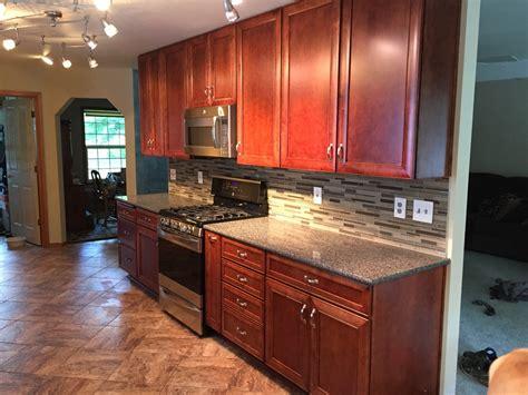 updated kitchen cabinets galley style baths the updated galley style kitchen