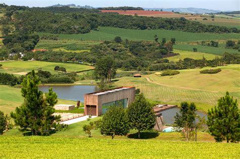 contemporary hillside home in brazil disappears into the landscape contemporary hillside home in brazil disappears into the