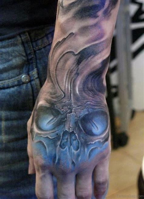 skull hand tattoo 80 classic skull tattoos on