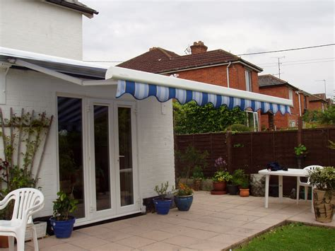 patio door awning patio awning stone patio idea in orange county with an awning full size of