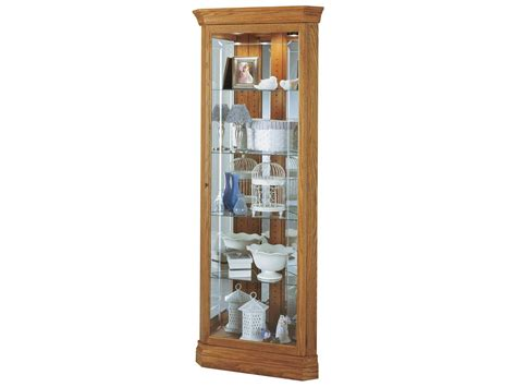 howard miller hammond golden oak corner curio cabinet 680347