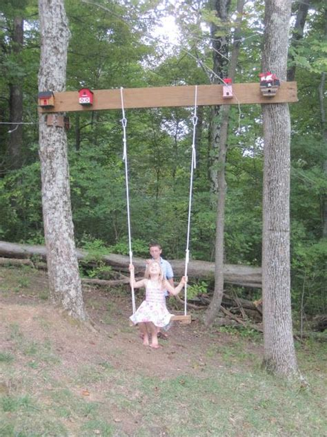 hanging a swing between two trees tree swing outdoors y pinterest