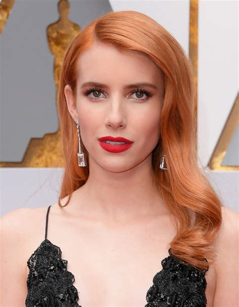 emma roberts stuns with loose curls amp bright red lip at