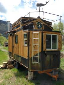 tiny houses for sale in colorado custom tiny house features hobbit door to a balcony curbed