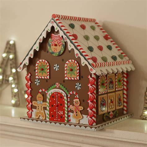 wooden advent calendar house wooden gingerbread house advent calendar by little ella james notonthehighstreet com