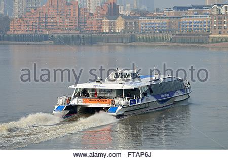 view of a thames clipper leaving canary 169 robert lamb a thames clipper river bus boat travelling on the river