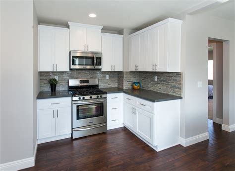 White Kitchen Cabinets Grey Floor Modern Kitchen With Warm Wood Floors Gray Paint White Cabinets Gray Counters Gray Tiles And