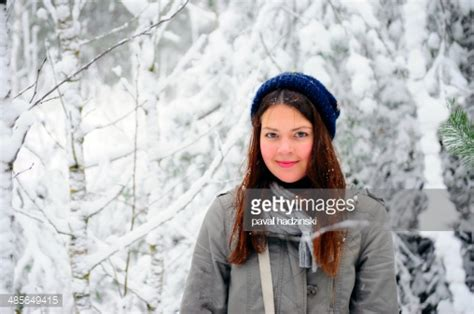 girl with brown hair in snow brown hair girl in the white snow forest stock photo