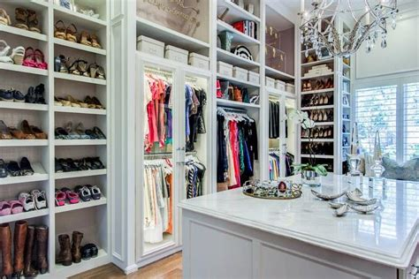 Shoe Closet With Doors Walk In Closet With Paneled Bi Fold Wardrobe Closet Doors Transitional Walk In Closet With Slanted Shoe Shelves Transitional Closet