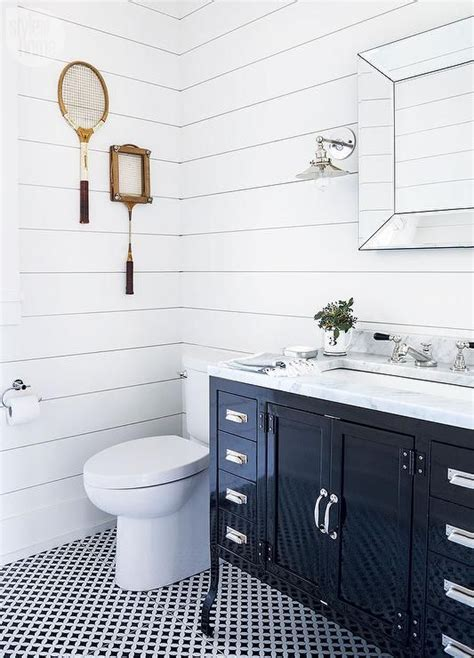 LVZ Design   Black and white cottage bathroom features a