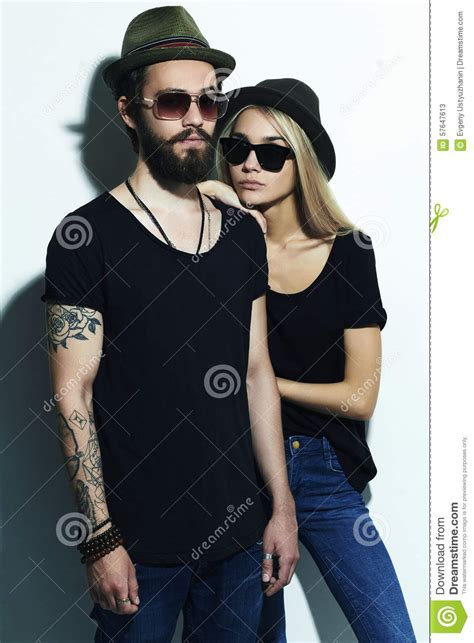 tattoo couple model fashion beautiful couple in hat together hipster boy and