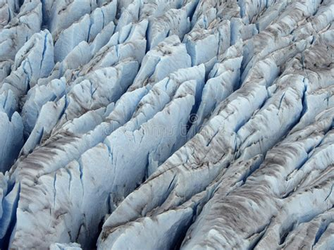 plan b icy closer aerial view of icy blue color crevasse of glacier
