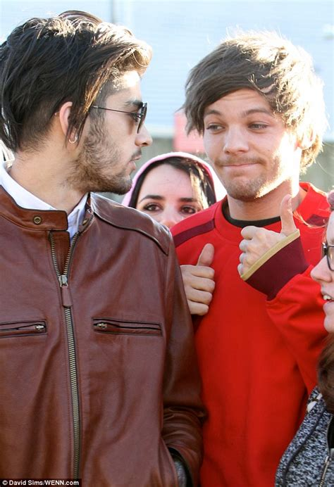 zayn malik leads one direction s louis tomlinson as they
