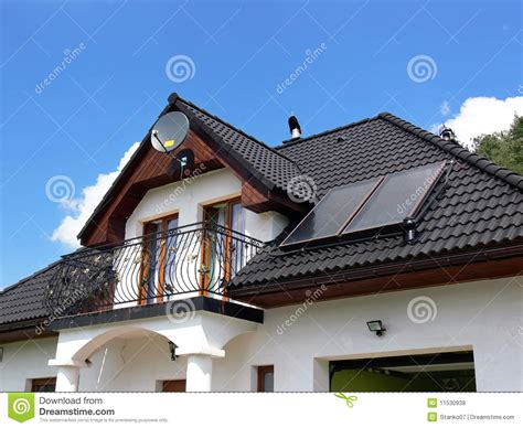 buy solar panels for house modern house with solar panels on the roof for water heating stock image