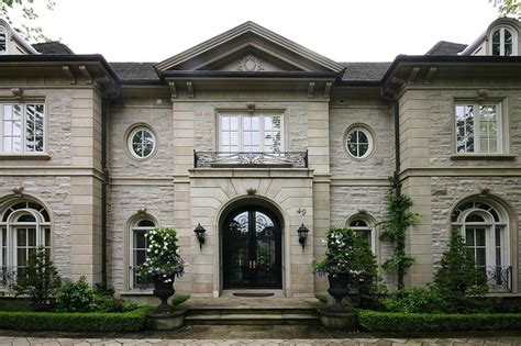 french chateau style home in stucco cast stone stone mansion french home exterior pricey pads
