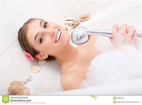 fun in the bathtub singing spa beautiful happy smiling girl sexy woman lying