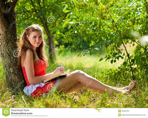 beautiful outdoors beautiful happy smiling women reading outdoors stock photo