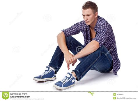 handsome sitting on the floor stock images image