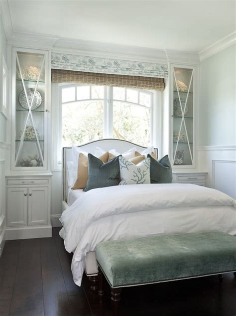 bed by the window headboard in front of window design ideas