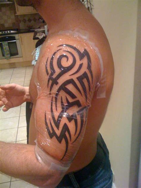 white ink tribal tattoo black ink tribal arm for