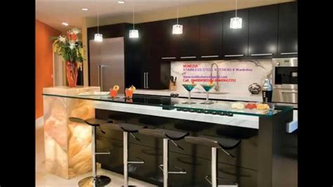 Latest Home Design In Kerala by Acrylic Stainless Steel Finish Modular Kitchen Thrissur