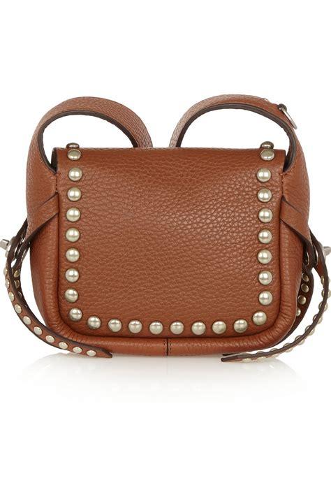 lyst coach dakotah studded textured leather shoulder bag in brown