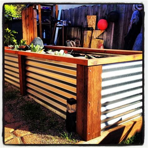 corrugated tin and redwood planter boxes yard