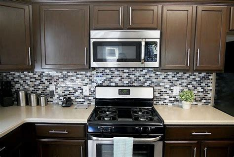 Painting Kitchen Cabinets Dark Brown www remodelaholic com 2012 04 sleek dark chocolate painted cabinets