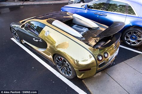 Gold Plated Bugatti Veyron Price Gold Bugatti Veyron Draws Crowds And Sell Seized