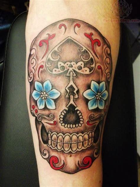 sugar skull face tattoo sugar skull blue flower