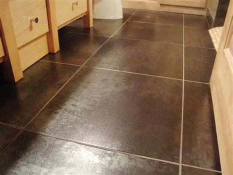 best floor color to hide dirt 25 best ideas about brown tile bathrooms on pinterest