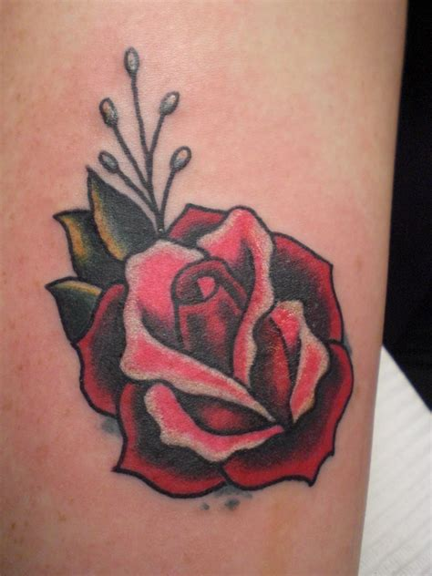 rose tattoos on the side memorable 3 thigh on