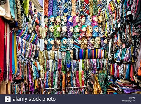 scarf and shop in fez medina morocco stock