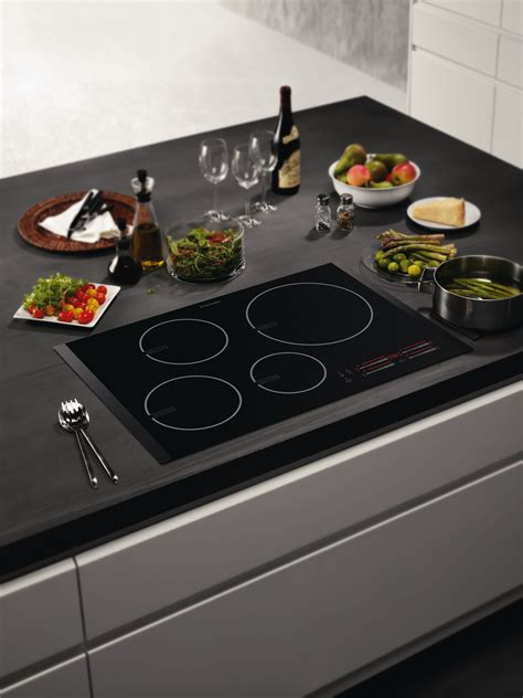 induction hob or not new sleek black glass induction hob from electrolux electrolux newsroom uk