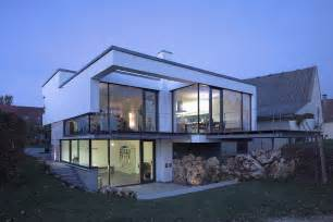 level house glass walls balcony evening lighting contemporary split