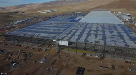 tesla battery factory nevada elon musk s tesla megafactory in the nevada desert begins