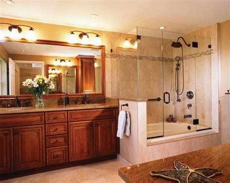 giving head in bathroom cherry wood vanity and large glass shower and bathtub